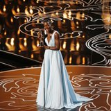"Lupita Nyong'o, best supporting actress winner for her role in ""12 Years a Slave"", reacts on stage at the 86th Academy Awards in Hollywood,"
