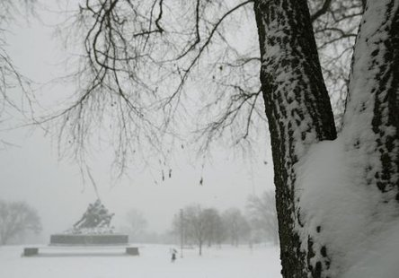 The U.S. Marine Corps War Memorial (L) is seen during blizzard conditions in Arlington, Virginia during a snow storm in the Washington metro area March 3, 2014.