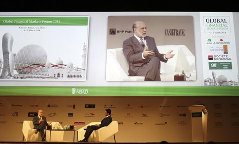 Former Federal Reserve Chairman Ben Bernanke (L) talks during Global Financial Markets Forum in Abu Dhabi March 4, 2014. REUTERS/Ahmed Jadal