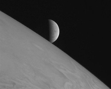 New Horizons took this image of the icy moon Europa rising above Jupiter's cloud tops after the spacecraft's closest approach to Jupiter. RE