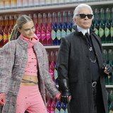 German designer Karl Lagerfeld (R) and model Cara Delevingne appear at the end of his Fall/Winter 2014-2015 women's ready-to-wear collection