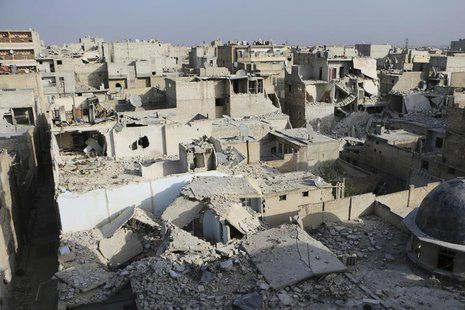 A general view of damage after what activists said was an air strike by forces loyal to Syria's President Bashar al-Assad in the Al-Maysar n