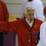 Russia's men's ice hockey coach Zinetula Bilyaletdinov (C) talks to players during a team practice at the 2014 Sochi Winter Olympics, Februa