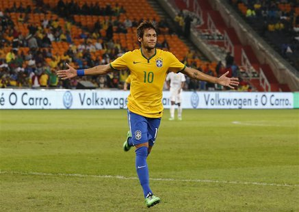 Brazil's Neymar celebrates his goal against South Africa during their international friendly soccer match at the First National Bank (FNB) S