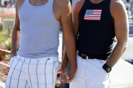 A gay couple holds hands during a rally in support of the United States Supreme Court decision on marriage rights in San Diego, California J