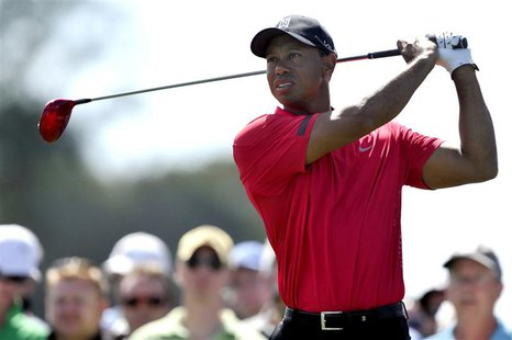 Mar 2, 2014; Palm Beach Gardens, FL, USA; Tiger Woods drives on nine during the final round of The Honda Classic golf tournament at PGA Nati