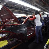 Workers assemble a pre-production 2013 Dodge Dart during a tour of the Chrysler Belvidere Assembly plant in Belvidere, Illinois February 2,
