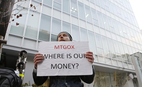 Kolin Burges, a self-styled cryptocurrency trader and former software engineer who came from London, holds a placard to protest against Mt.
