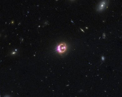 Multiple images of a distant quasar are visible in this undated combined view from NASA's Chandra X-ray Observatory and the Hubble Space Tel