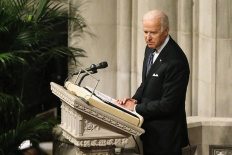 U.S. Vice President Joe Biden delivers a tribute during the National Memorial Service for Nelson Mandela at the National Cathedral in Washin