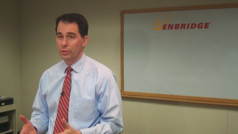Wisconsin Governor Scott Walker (R) talks with reporters following a tour of the Enbridge Tank site in Superior