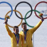 Australia's Mathew Belcher and Malcolm Page pose with their gold medals for the men's 470 sailing class at the London 2012 Olympic Games in