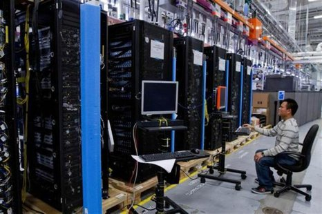 Hewlett-Packard ProLiant commercial data servers destined for cloud computing are assembled by workers at a company manufacturing facility i