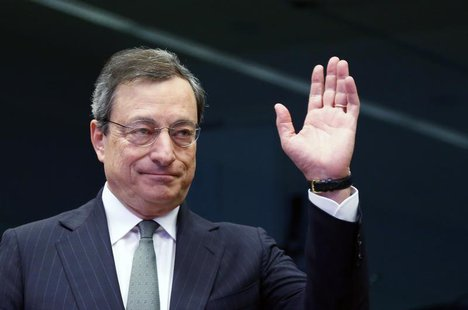 European Central Bank (ECB) President Mario Draghi waves as he arrives at an eurozone finance ministers meeting in Brussels February 17, 201