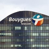A Bouygues Telecom company logo is seen on the facade of the Sequana tower, the company's headquarters, in Issy-Les-Moulineaux, near Paris,