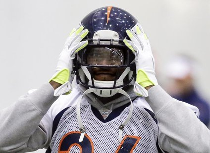 Denver Broncos cornerback Champ Bailey adjusts his helmet during their practice session for the Super Bowl at the New York Jets Training Cen