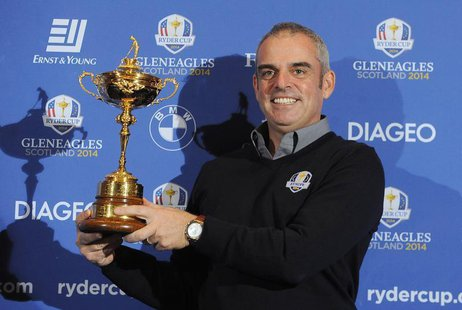 Paul McGinley of Ireland poses with the Ryder Cup during a news conference after being named the European Ryder Cup captain at the St. Regis
