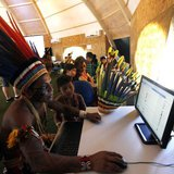 Brazilian indigenous people use computers inside a tent during the XII Games of the Indigenous People in Cuiaba November 13, 2013. REUTERS/P
