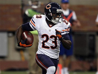 Chicago Bears wide receiver Devin Hester carries the ball against the Detroit Lions during the first half of their NFL football game in Detr