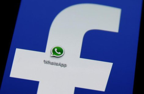 A Whatsapp icon is seen on a Samsung Galaxy S4 phone screen with a Facebook logo in the central Bosnian town of Zenica, February 20, 2014. R