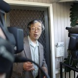 A man widely believed to be Bitcoin currency founder Satoshi Nakamoto is surrounded by reporters as he leaves his home in Temple City, Calif