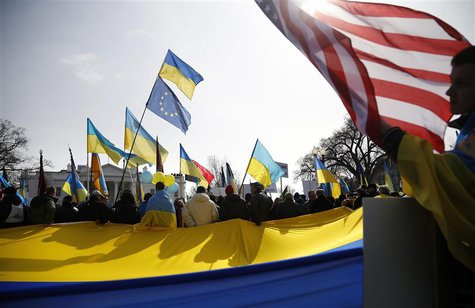 Demonstrators call on the U.S. to take measures against Russia's recent actions in Ukraine, in front of the White House in Washington March