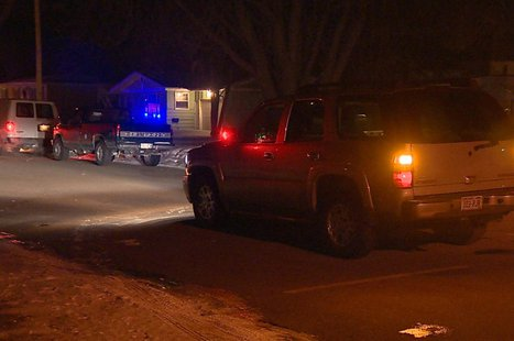 Authorities investigate a shooting that left two people dead on Bowen St. in Brandon, March 5, 2014. (Photo from: FOX 11).