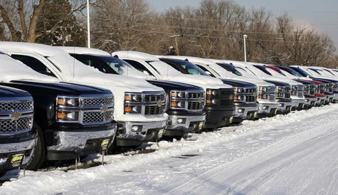 A line of Chevrolet trucks made by General Motors are seen for sale at a dealer in Wheat Ridge, Colorado February 6, 2014 file photo. CREDIT: REUTERS/RICK WILKING