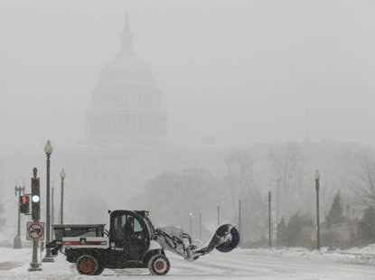 A snow sweeper attempts to keep a street open in front of the U.S. Capitol during a blizzard in Washington March 3, 2014.  CREDIT: REUTERS/GARY CAMERON