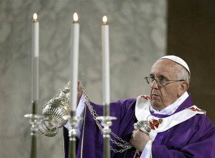 Pope Francis blesses the altar during Ash Wednesday at Santa Sabina Basilica in Rome March 5, 2014. CREDIT: REUTERS/MAX ROSSI