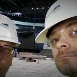 Craig Mattick and Chris Tubbs watch the scoreboard go up at the Events Center.
