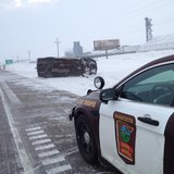Minnesota State Patrol Sgt. Jesse Grabow on the scene of a rollover on Hwy 10 east of Dilworth