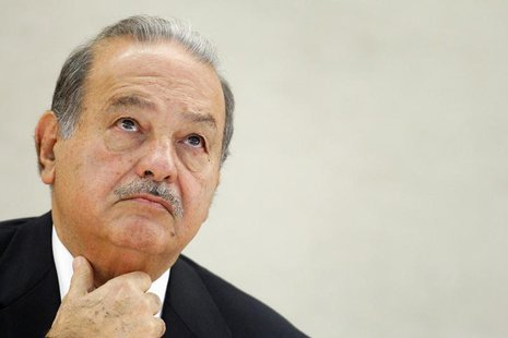 Mexican telecommunications and retail tycoon Carlos Slim Helu waits before delivering his speech on the impact of new technologies during a