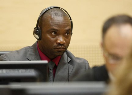 Germain Katanga, a Congolese national, sits in the courtroom of the ICC during the closing statements in the trial against Katanga and Ngudj