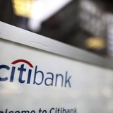 A sign is seen on the door of a Citibank branch in New York, October 18, 2010. REUTERS/Brendan McDermid