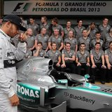 Mercedes Formula One drivers Lewis Hamilton of Britain arrive to pose with team members at the Interlagos circuit in Sao Paulo November 24,