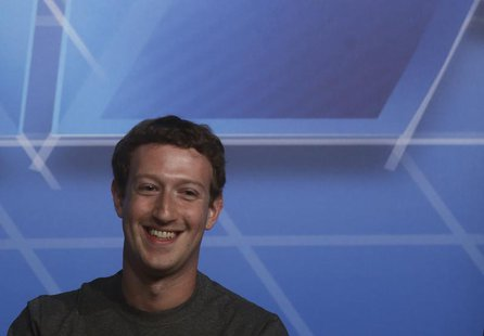 Facebook Chief Executive Officer Mark Zuckerberg smiles in the stage before delivering a keynote speech during the Mobile World Congress in