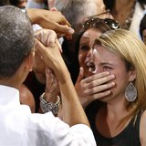 A woman cries while meeting U.S. President Barack Obama at the Coral Reef High School in Miami, Florida, March 7, 2014. REUTERS/Yuri Gripas