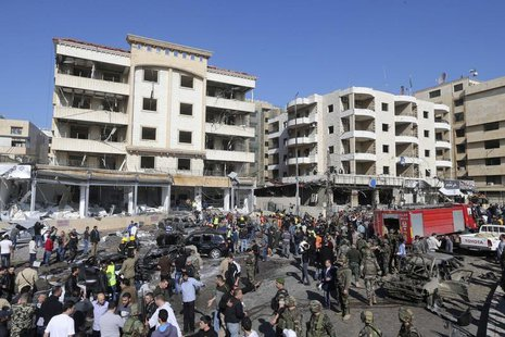 Civil defence members, army soldiers and police officers gather at the site of an explosion near Iran's cultural centre in the southern subu