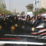 "Iraqi Protesters hold a banner during a demonstration against the draft of the ""Al-Jafaari"" Personal Status Law during International Women's"
