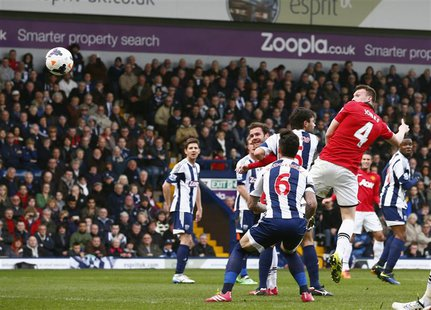Manchester United's Phil Jones (R) scores a goal against West Bromwich Albion during their English Premier League soccer match at The Hawtho