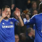 Chelsea's John Terry (L) celebrates with Demba Ba after defeating Tottenham Hotspur in their English Premier League soccer match at Stamford