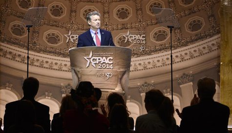 Senator Rand Paul (R-KY) pauses in his remarks as guests applaud at the Conservative Political Action Conference (CPAC) in Oxon Hill, Maryla