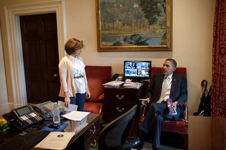 U.S. President Barack Obama talks with Director of Scheduling and Advance Alyssa Mastromonaco in the Outer Oval Office, in this white House