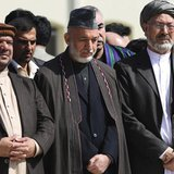 Afghan President Hamid Karzai (C) and Vice Presidents Mohammad Qasim Fahim (L) and Karim Khalili attend the funeral ceremony of slain former