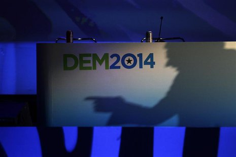California Lt. Governor Gavin Newsom casts a shadow on a banner as he speaks at the 2014 California Democrats State Convention at the Los An