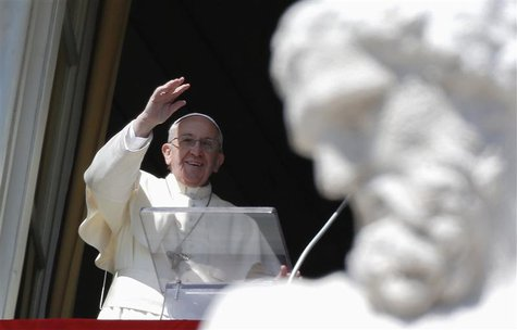 Pope Francis waves as he leads the Angelus prayer from the window of the Apostolic palace in Saint Peter's Square at the Vatican March 9, 20
