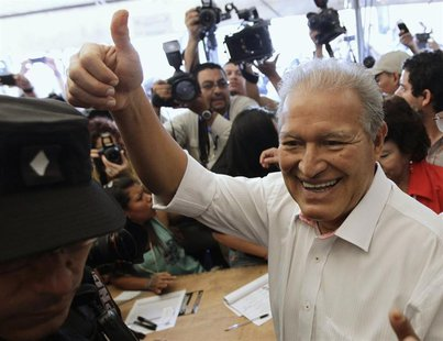 Salvador Sanchez Ceren, the presidential candidate for the Farabundo Marti Front for National Liberation (FMLN), gestures after casting his