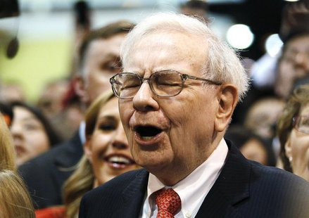 Berkshire Hathaway Chairman Warren Buffett reacts at a newspaper throwing competition before the company's annual meeting in Omaha May 4, 20