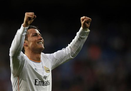 Real Madrid's Cristiano Ronaldo celebrates after scoring a goal against Levante during their Spanish first division soccer match at Santiago